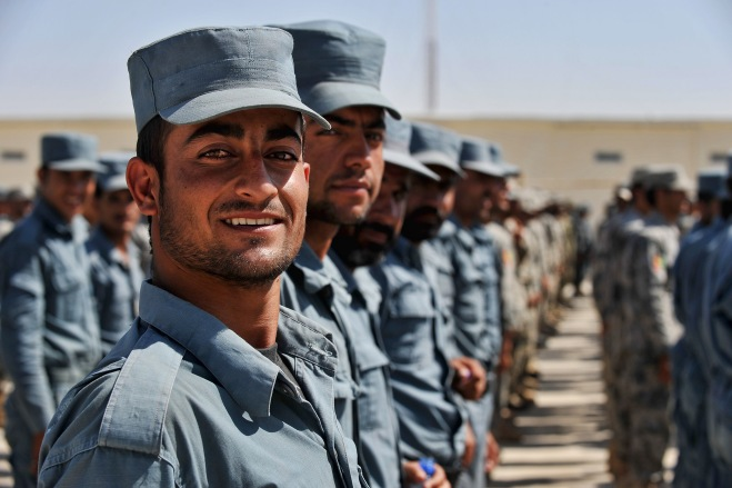 A Proud Afghan National Policeman smiles for the camera