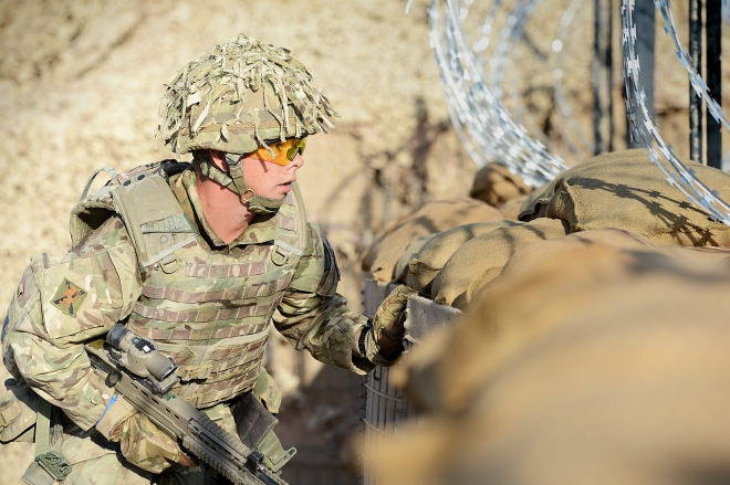 A soldier takes cover during RSOI training