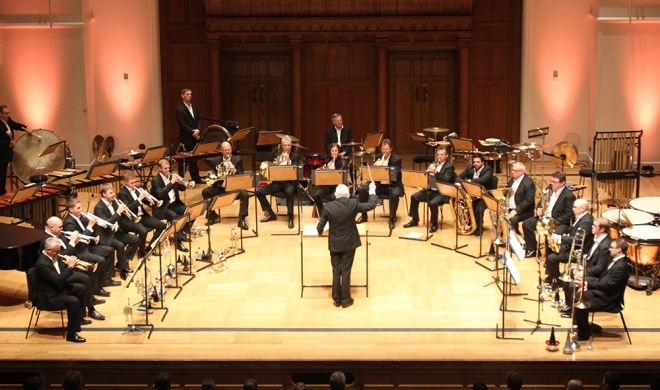 Lance Sergeant John Storey sits poised with his Euphonium on the left of the stage