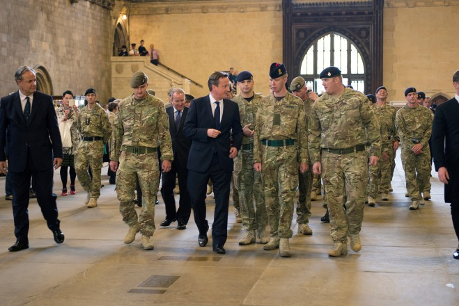 Prime Minister David Cameron with members of 1 Mech Brigade.
