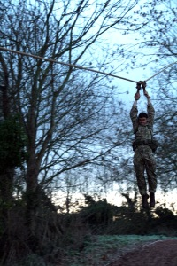 Spr Joseph starts Tarzan Assault Course with the Commando Slide. This has to be done whilst carrying 32 lbs of kit (webbing and rifle)