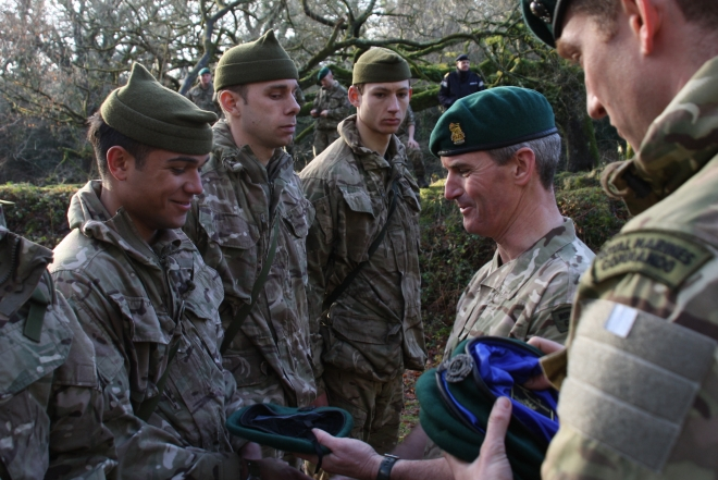 Receiving the green beret from the Brigade Commander.