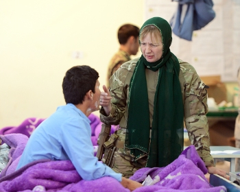 Talking to the patients on one of the ANA hospital wards at Camp Shorabak.