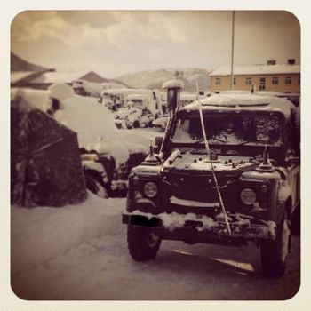 A snow-covered Land Rover