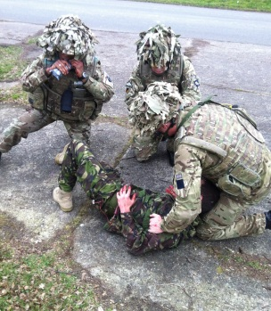 Reservists of 159 Supply Regiment deal with a 'casualty' during Mission Specific Training for Op HERRICK 20.