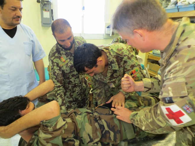 An Afghan Warrior is treated by Afghan medics.