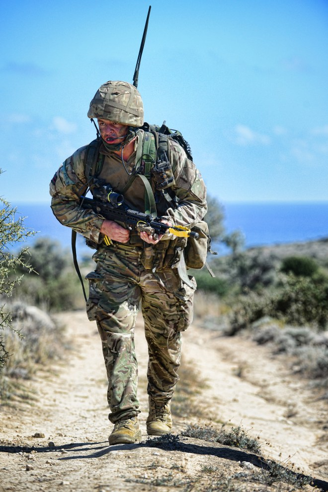 A soldier battles with the hills and heat during an attack