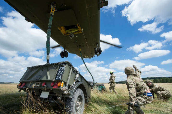 The Army Air Corps conducting underslung load training with the help of an RAF Chinook.