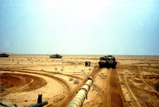 Desert Storm breaks. D Squadron leaving Staging Area 3, just south of the Saudi/Iraq border berm.