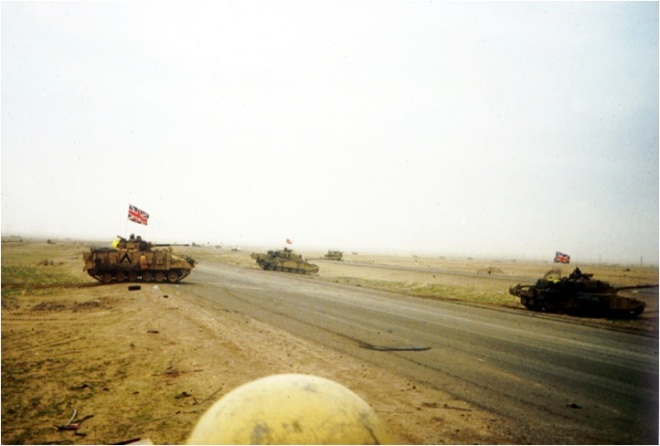 Mission accomplished. The Basra Rd by the UN deadline. D Squadron crosses the Basra Rd. Note that we had heard of the RRF Warrior which had been taken out by a US A-10 tank killing aircraft. We broke out the flags to deter further blue on blue air attacks