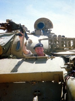 Capt Tim Purbrick in the driver's seat of a captured and intact T-55 tank, carrying a mini-Uzi