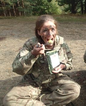 OCdt Taylor tucking into her rations. Yum!