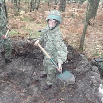 OCdt Malan still smiling whilst digging her fire trench!